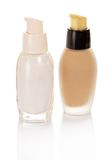 Two glass small bottles with basis for makeup Stock Photo