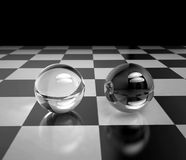 Two glass spheres on a chessboard Stock Photos