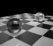 Two glass spheres on a chessboard Stock Photo