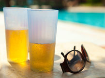 Two glass and sunglasses Stock Photos