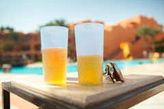Two glass and sunglasses Royalty Free Stock Images