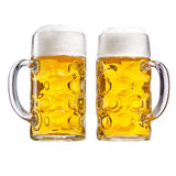 Two glass tankards of chilled frothy beer royalty free stock photography