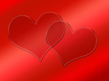 Two glass transparent hearts on red Royalty Free Stock Image