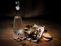 Two glass for vodka with dried capelin and bread Royalty Free Stock Images