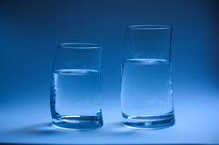 Two glass of water curved Royalty Free Stock Image