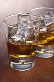Two glass of whisky. On a wooden table Stock Photo