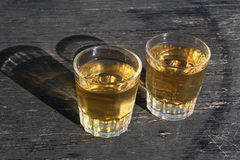 Two glass of white vine. On oak barrel Royalty Free Stock Photography