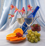 Two glass of white wine and blue bottle Stock Photo