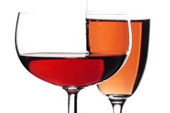 Two glass of wine. Two glass of red and pink wine. Isolated white Royalty Free Stock Photos