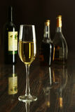 Two Glass of wine, brandy or cognac on the mirror wooden table Royalty Free Stock Photography