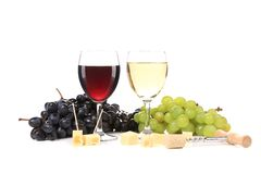Two glass of wine with grapes and corkscrew. Royalty Free Stock Photography
