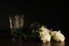 Two glass with wine and roses Stock Image