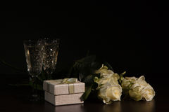 Two glass with wine and roses Stock Images