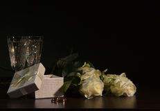 Two glass with wine and roses Stock Photos