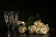 Two glass with wine and roses Royalty Free Stock Photo
