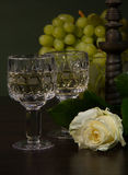 Two glass with wine and roses Royalty Free Stock Photos