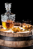 Two glassed of aged brandy or whiskey on the rocks Royalty Free Stock Photo