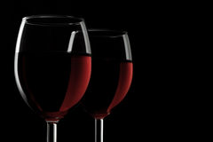 Two glassed of red wine isolated on black background royalty free stock photos