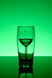 Two glasses. Broken wine glass behind beer glass - alcoholism concept royalty free stock photos