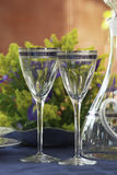 Two glasses. Two crystal glasses and table complements Royalty Free Stock Image