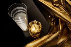 Two glasses. On black background with gold Royalty Free Stock Photo