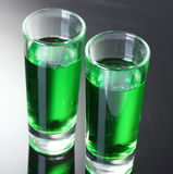 Two glasses of absinthe. On grey background royalty free stock photography