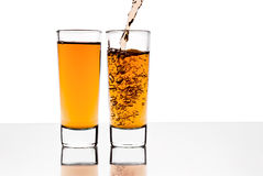 Two glasses with alcohol Stock Images