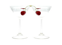 Two glasses of alcohol drink with cherry  Stock Image