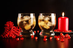Two glasses with alcohol and ice Royalty Free Stock Image
