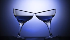 Two glasses of an alcoholic beverage on a colored background.  Stock Image