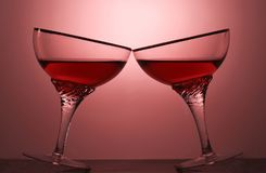Two glasses of an alcoholic beverage on a colored background.  Stock Images