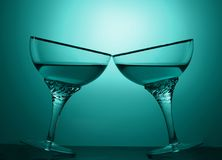 Two glasses of an alcoholic beverage on a colored background.  Royalty Free Stock Images