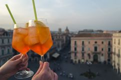 Two glasses of aperol spritz on the roof top of Catania. The cit stock images