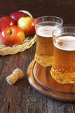 Two glasses of Apple Cider and red apples Royalty Free Stock Photography