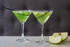 Two glasses of apple martini Stock Images