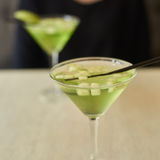 Two glasses of apple martini Royalty Free Stock Photos