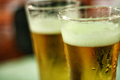 Two glasses of beer. Tall glass of fresh beer on a table Stock Photography