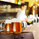 Two glasses of beer in the bar Stock Images
