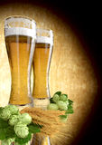 Two glasses of beer with barley and hops - 3D render Royalty Free Stock Photos