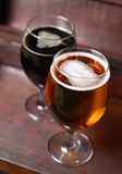 Two glasses of beer in a case Royalty Free Stock Photo