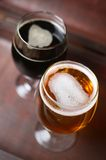 Two glasses of beer in a case Royalty Free Stock Photos
