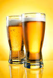 Two glasses of beer close-up with froth Stock Images