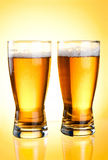 Two glasses of beer close-up with froth Royalty Free Stock Images