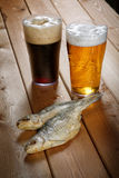 Two glasses of beer with dried fish Stock Image
