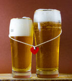 Two glasses of beer for lovers. With red heart Royalty Free Stock Photo