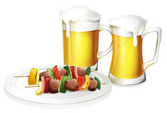 Two glasses of beer with a plate of barbeque Stock Photos