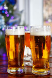 Two glasses of beer standing Royalty Free Stock Photography