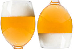 Two glasses of beer on a white background stock photos
