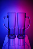 Two glasses in bicolor light Stock Image