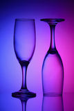 Two glasses in bicolor light Stock Photos